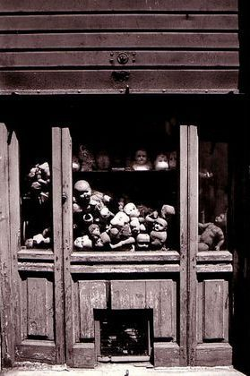 Porcelain doll heads and bodies piled in the window of Rome's famous doll hospital.
