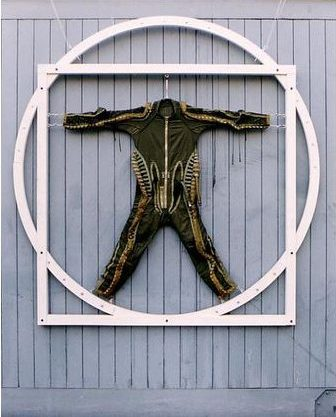 Human Proportions 1994. G-suit suspended in plywood construction relating to Leonardo's drawing, Vitruvian Man.